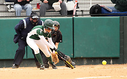 30 March 2013:  Audra James during an NCAA Division III women's softball game between the DePauw Tigers and the Illinois Wesleyan Titans in Bloomington IL<br /> <br /> Umpire is Jay MacDaniels of Pekin IL