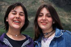 Two teenage girls smiling,