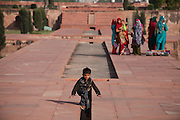 A boy is plying where once water used to be, at the Mughal garden of Ram Bagh in Agra, on the sides of the heavily polluted and semi-dry Yamuna River.