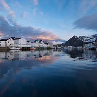 Mountain reflection in Harbour at scenic fishing village of Henningsvær, Austvågøy, Lofoten Islands, Norway