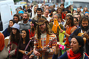 Rainbow family street parade in the village of Salto thanking for the hospitality. European Rainbow Gathering of 2011 in Portugal