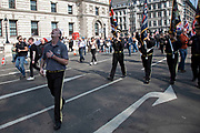 Musselburgh True Defenders Flute Band from Northern Ireland play as thousands of Leave supporters gathered in Parliament Square to protest against the delay to Brexit, on the day the UK had been due to leave the EU on 29th March 2019 in London, United Kingdom. As parliament debated and voted inside the commons, rejecting the Withdrawal Agreement again, outside in Westminster various groups of demonstrators including the Yellow Jackets, Leave Means Leave supporters and the Democratic Football Lads Alliance, gathered to voice their wish to leave the European Union, and their frustration that Brexit is not being delivered, waving Union flags and Believe in Britain placards.
