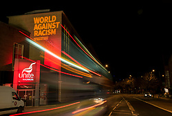 "© Licensed to London News Pictures; 20/03/2021; Bristol, UK. The words ""World Against Racism"" are projected onto the side of Tony Benn House, the south west regional offices of Unite the Union, for the World Against Racism online rally on UN Anti-Racism Day on 20 March. The 21 March is the International Day for the Elimination of Racial Discrimination. Photo credit: Simon Chapman/LNP."