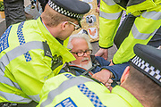 Police warn people blocking Waterloo Bridge under the public order act and then arrest them if they refuse to move to Marble Arch. It is mostly good humoured but some are dragged away to cheers from the remainder -  Day 2 - Protestors from Extinction Rebellion block several (Hyde Park, Oxford Cuircus, Warterloo Bridge and Parliament Square) junctions in London as part of their ongoing protest to demand action by the UK Government on the 'climate chrisis'. The action is part of an international co-ordinated protest.