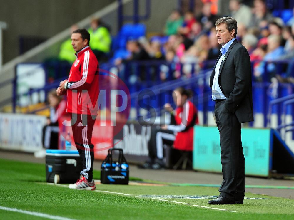 Bolton Wanderers caretaker manager, Jimmy Phillips stands on the touch line with Bristol City Manager, Derek McInnes (left) - Photo mandatory by-line: Joe Meredith/JMP  - Tel: Mobile:07966 386802 20/10/2012 - Bolton Wanderers v Bristol City - SPORT - FOOTBALL - Championship -  Bolton  - Reebok Stadium