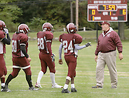 Cornwall-on-Hudson, New York - New York Military Academy football coach Les McMillen talks to his players during a high school football game against the Harvey School on Oct. 17, 2009. NY