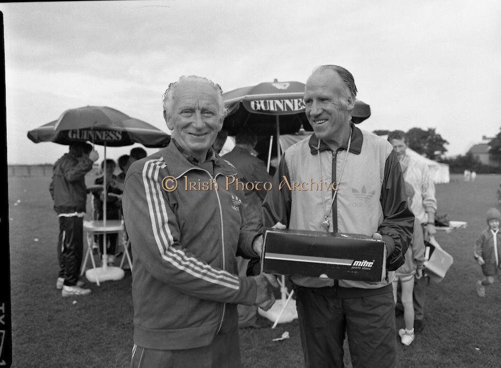 """Guinness Family Day At The Iveagh Gardens. (R83)..1988..02.07.1988..07.02.1988..2nd  July 1988..The family fun day for Guinness employees and their families took place at the Iveagh Gardens today. Top at the bill at the event were """"The Dubliners"""" who treated the crowd to a performance of all their hits. Ireland's penalty hero from Euro 88, Packie Bonner, was on hand to sign autographs for the fans."""