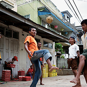 May 15, 2013 - Meiktila, Myanmar: Teenagers play chinlone, a sort of foot volley with a wicker ball in Meiktila, a city in central Myanmar that in recent month has been stage for anti-Muslim violence. (Paulo Nunes dos Santos/Polaris)