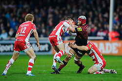 Saracens Lock (#5) Alistair Hargreaves is tackled by Gloucester Fly-Half (#10) Freddie Burns and Flanker (#7) Matt Kvesic during the first half of the match - Photo mandatory by-line: Rogan Thomson/JMP - Tel: Mobile: 07966 386802 - 04/01/2014 - SPORT - RUGBY UNION - Kingsholm Stadium, Gloucester - Gloucester Rugby v Saracens - Aviva Premiership.