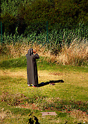 A Moroccan man makes his mid-day prayer in the middle of a field in Fes, Morocco on Wednesday, May 30, 2007. People will choose any available spot to give praise to Allah. (PHOTO BY TIMOTHY  D. BURDICK)