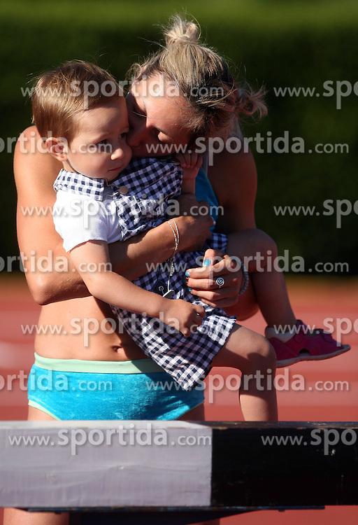 Alenka Bikar kisses her daughter Pia at Athletic National Championship of Slovenia, on July 19, 2008, in Stadium Poljane, Maribor, Slovenia. (Photo by Vid Ponikvar / Sportal Images).