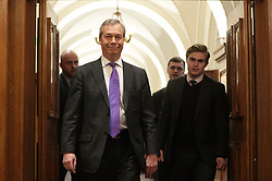 © Licensed to London News Pictures . 27/03/2017 . London , UK . NIGEL FARAGE arrives. UKIP leader Paul Nuttall delivers a speech setting out six tests on which UKIP will judge British Prime Minister Theresa May's Brexit negotiations , at the Marriott County Hall in Westminster . On Wednesday the British Government will trigger Article 50 of the Lisbon Treaty and commence Britain's withdrawal from the European Union . Photo credit : Joel Goodman/LNP