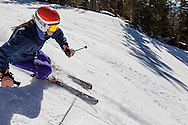 young woman skier, skiing fast