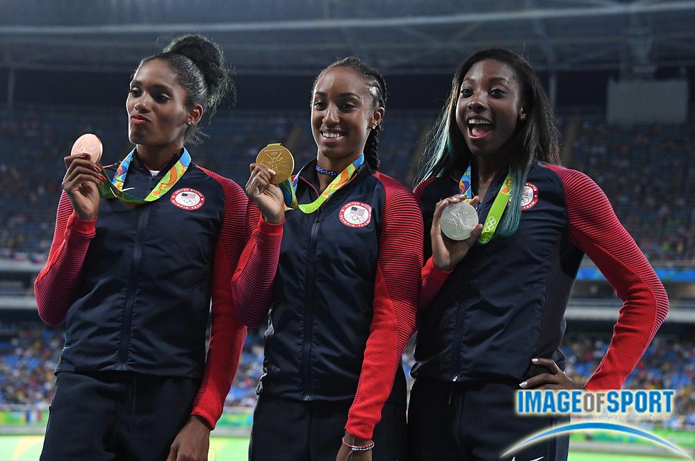 Aug 18, 2016; Rio de Janeiro, Brazil; Women's 100m hurdles gold medalist Brianna Rollins (USA), center, poses with silver medalist Nia Ali (USA), right and bronze medalist Kristi Castlin (USA) during the 2016 Rio Olympics at Estadio Olimpico Joao Havelange.