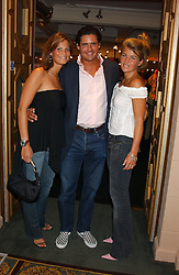 Left to right, JULIA BAUMHOFF, EDWARD TAYLOR and AMBER NUTTAL at a party to celebrate 'Made in Italy at Harrods' - a celebration of Italian fashion food and wine, design and interiors, art and photography, cinema and music, beauty and glamour.  The party was held in the Georgian Restaurant at Harrods, Knightsbridge, London on 9th September 2004.<br /><br />PICTURES LICENCED UNTIL 9/3/2004 FOR USE TO PROMOTE THE 'MADE IN ITALY' EVENT/S ONLY.
