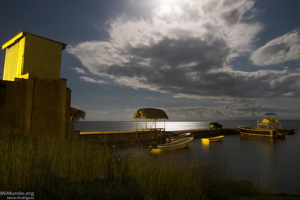 Night panorama of a pier in Punta Gorda, Toledo, Belize. January 27, 2013.