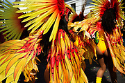 Notting Hill Carnival August 28th 2017. West London, England. A group of dancers in yellow and orange flame like costumes.