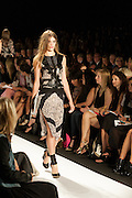 A black and beige dress wuith lace accents and harness top at the BCBGMAXAZRIA show at the Spring 2013 Mercedes Benz Fashion Week show in New York.