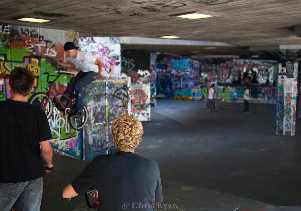 Bikers doing tricks at a skate park in London, United Kingdom