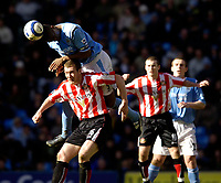 Photo: Jed Wee.<br /> Manchester City v Sunderland. The Barclays Premiership. 05/03/2006.<br /> <br /> Manchester City's Sylvain Distin climbs over Sunderland's Kevin Kyle to win the ball.