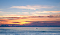 Sunset over Puget Sound from Fort Casey State Park on Whidbey Island, Washington.
