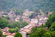 The village of Malleval with the old stone church and stone and ochra coloured houses in one of the valleys leading down to the rhone river.  Domaine Pierre Gaillard, Malleval, Ardeche, ardèche, France, Europe