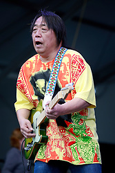 03 May 2013. New Orleans, Louisiana,  USA. .New Orleans Jazz and Heritage Festival. .June Yamagishi plays with Papa Grows Funk..Photo; Charlie Varley.