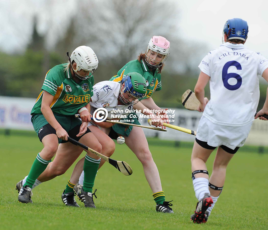 24-04-11. Meath v Kildare - Irish Daily Star National Camogie League Div. 3 Final at Ashbourne.<br /> Jane Dolan (Left) and Kristina Troy in a tussle for possession with Siobhan Hurley, Kildare.<br /> Photo: John Quirke / www.quirke.ie<br /> ©John Quirke Photography, Unit 17, Blackcastle Shopping Cte. Navan. Co. Meath. 046-9079044 / 087-2579454.
