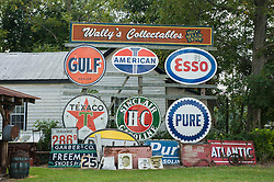 collection of old signs outdoors at a store in South Carolina