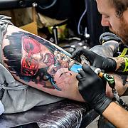Jarda Tattoo London, Tattoo a client at The Great British Tattoo Show, on 26 May 2019, London, UK.