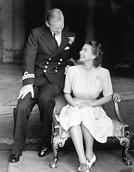 The engagement of Princess Elizabeth to Lieutenant Philip Mountbatten is announced and the happy young couple are pictured together at Buckingham Palace