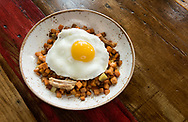 9 FEB. 2018 -- ST. LOUIS -- The Breakfast Hash at Squatter's Cafe is comprised of sweet potatoes, 100 layer apples, Missouri bourbon butterscotch, Geisert Farms pork confit and a Barnival egg over easy, as photographed Friday, Feb. 9, 2018 at the restaurant in the KDHX Larry J. Weir Center for Independent Media in the Grand Center neighborhood of St. Louis. Photo © copyright 2018 Sid Hastings.