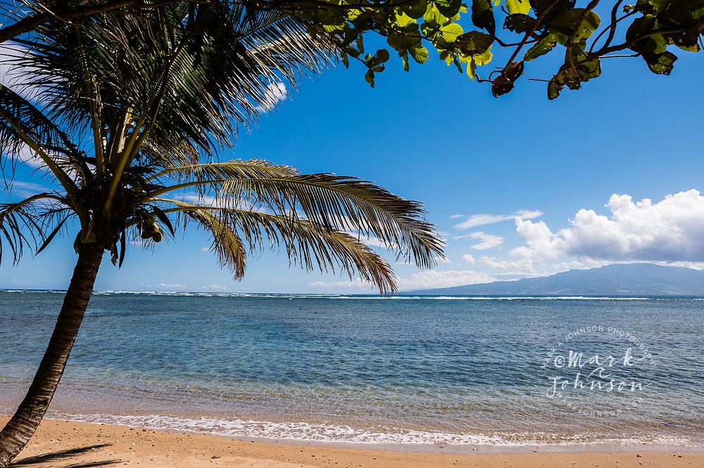 A view of Maui island from a beach on Molokai, Hawaii