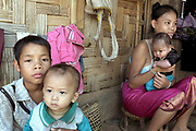 A young Laoseng ethnic minority woman with her baby and other children outside her home in Ban Sopkang, Phongsaly province, Lao PDR. The remote and roadless village of Ban Sopkang is situated along the Nam Ou river and will be relocated due to the construction of the Nam Ou Cascade Hydropower Project Dam 7.