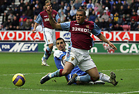 Photo: Paul Thomas.<br /> Wigan Athletic v Aston Villa. The Barclays Premiership. 19/11/2006.<br /> <br /> Wilfred Bouma (R) of Villa wins the ball ahead of Paul Scharner.