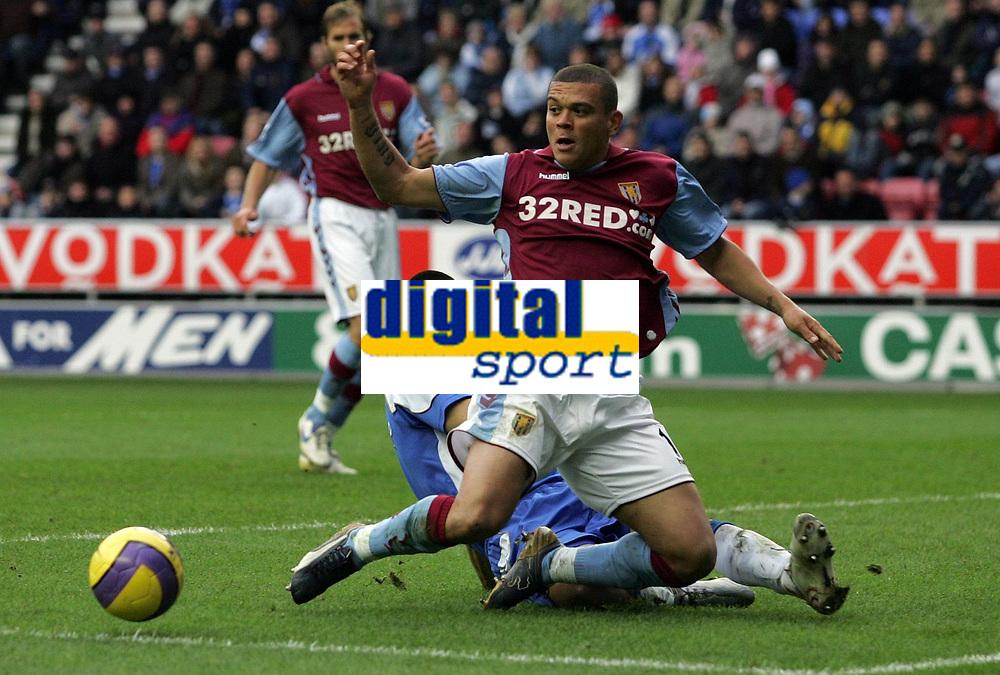 Photo: Paul Thomas.<br /> Wigan Athletic v Aston Villa. The Barclays Premiership. 19/11/2006.<br /> <br /> Wilfred Bouma (R) of Villa wins the ball ahead of Paul Scharner.
