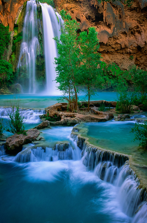 Havasu Canyon is a paradisiacal gorge where turquoise waters cascade into travertine pools and graceful willows and lofty cottonwoods provide shade and greenery in an extraordinary setting of towering red sandstone cliffs beneath a cerulean sky. It is a side branch of the Grand Canyon that was once the home of a prehistoric people but more recently it has been the occupied by the Havasupai for the past 800 years.