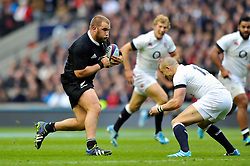 Owen Franks (New Zealand) goes on the attack - Photo mandatory by-line: Patrick Khachfe/JMP - Tel: Mobile: 07966 386802 16/11/2013 - SPORT - RUGBY UNION -  Twickenham Stadium, London - England v New Zealand - QBE Autumn Internationals.