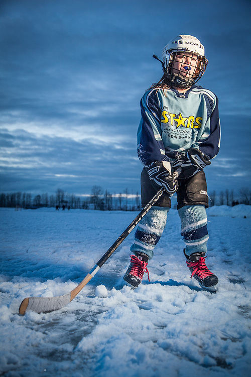 Hannah Katchen suits up in her hockey uniform on her 7th birthaday at Westchester Lagoon, Anchorage