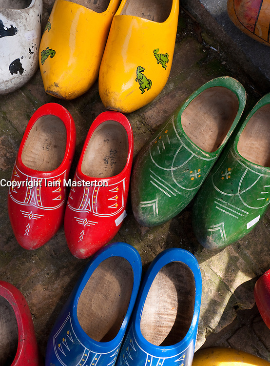 Colourful old red wooden dutch clogs outside house in The Netherlands