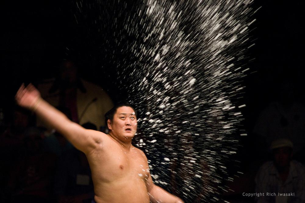 Tokitenku throws salt into the ring prior to his match at the 2005 Grand Sumo Championship Las Vegas tournament, Mandalay  Bay Resort & Casino, Las Vegas, Nevada