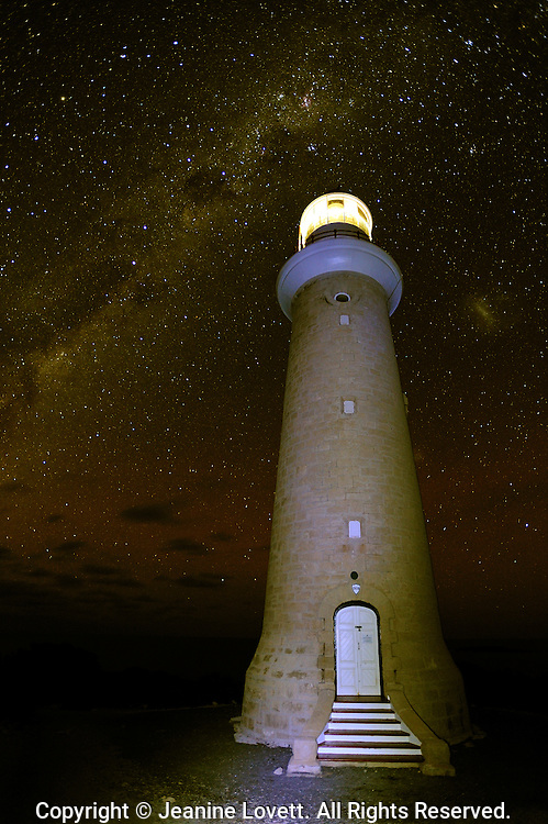 The Cape du Couedic Lighthouse on Kangaroo Island with starry milky way sky.