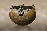 Phrygian bronze couldron with decorated winged figure handles . From Gordion. Phrygian Collection, 8th century BC - Museum of Anatolian Civilisations Ankara. Turkey. Against an art background .<br /> <br /> If you prefer you can also buy from our ALAMY PHOTO LIBRARY  Collection visit : https://www.alamy.com/portfolio/paul-williams-funkystock/phrygian-antiquities.html  - Type into the LOWER SEARCH WITHIN GALLERY box to refine search by adding background colour, place, museum etc<br /> <br /> Visit our CLASSICAL WORLD PHOTO COLLECTIONS for more photos to download or buy as wall art prints https://funkystock.photoshelter.com/gallery-collection/Classical-Era-Historic-Sites-Archaeological-Sites-Pictures-Images/C0000g4bSGiDL9rw