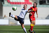 England's Bethany Mead gets the ball ahead of Rhian Cleverly of Wales. UEFA Womens U19 Championships 2013 match, Wales v England at Parc y Scarlets in Llanelli on Thursday 22nd August 2013. pic by Andrew Orchard ,Andrew Orchard sports photography,