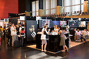 Some of the commercial booth area in the Perpignan convention center at Visa pour l'image International festival of photojournalism, held in Perpignan, France.  Getty photo agency booth.