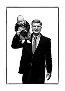 """Rep. Bill Crane, R-Arvada, holds his two month old grandson Logan Bennington (cq) on his shoulder as they pose for a portrait. Crane is a retired business systems engineer and was photographed with his six grandchildren. Crane said he brought his grandchildren because, """"they're a reflection of me"""". Crane is 57 years old.<br /> (Photo by MARC PISCOTTY / ©2006) CQ Rep. Bill Crane, R-Arvada and Logan Bennington"""