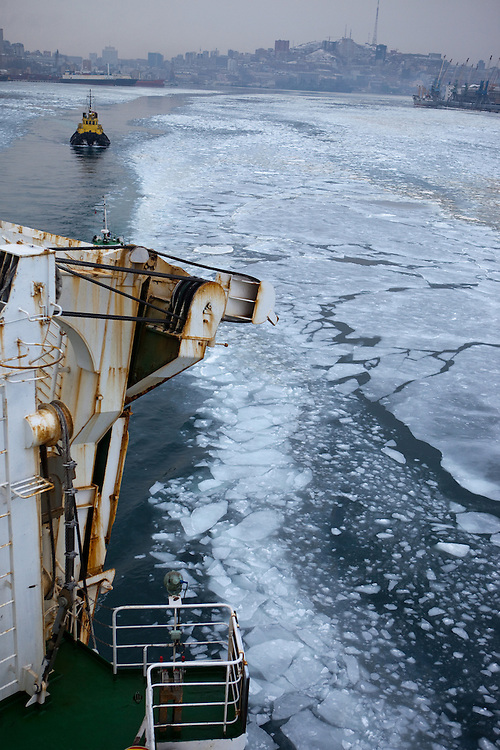 """Ice is covering the exit of Vladivostok port and the cruiser """"Eastern Star"""" is guided by navigators into direction South Korea. Photography : Björn Steinz"""