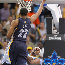 Jan 20, 2010; New Orleans, LA, USA; Memphis Grizzlies forward Rudy Gay (22) draws a foul from New Orleans Hornets forward James Posey (41) on a shot during the second half at the New Orleans Arena. The Hornets defeated the Grizzlies 113-111. Mandatory Credit: Derick E. Hingle-US PRESSWIRE