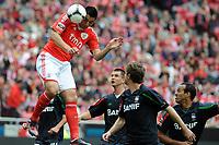 20120421: LISBON, PORTUGAL - Portuguese Liga Zon Sagres 2011/2012 - SL Benfica VS Maritimo<br /> In picture: Benfica's Oscar Cardozo, from Paraguay, top, heads the ball.<br /> PHOTO: Alvaro Isidoro/CITYFILES
