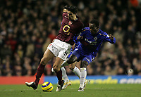 Photo: Lee Earle.<br /> Arsenal v Chelsea. The Barclays Premiership. 18/12/2005. Arsenal's Robin Van Persie (L) battles with Mickael Essien.